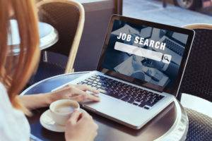 careers professional searching for jobs on laptop